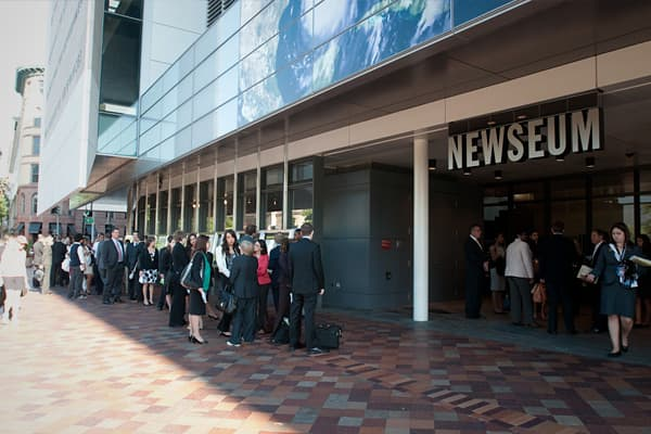 Guests line up outside the Newseum, the event's venue in Washington DC.