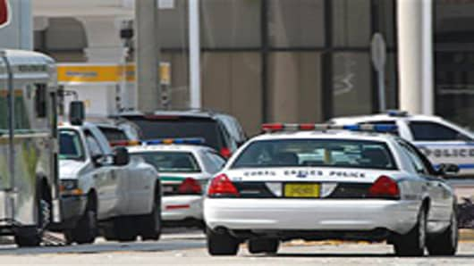 Authorities surround a Bank of America where a robbery may have turned into a hostage situation in Coral Gables, Fla. on Friday, Sept. 24, 2010.