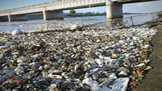 Plastic waste washed up in the Los Angeles River after a storm.