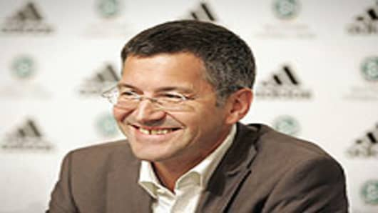 Herbert Hainer, CEO of Adidas smiles during a press conference on in Herzogenaurach, Germany.