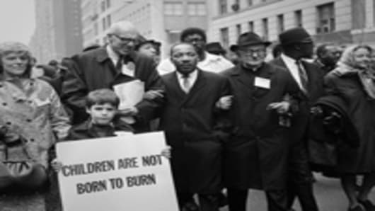 Civil rights leader Rev. Martin Luther King, Jr. is accompanied by famed pediatrician Dr. Benjamin Spock, Father Frederick Reed and union leader Cleveland Robinson 16 March, 1967, during an anti-Vietnam War demonstration in New York.