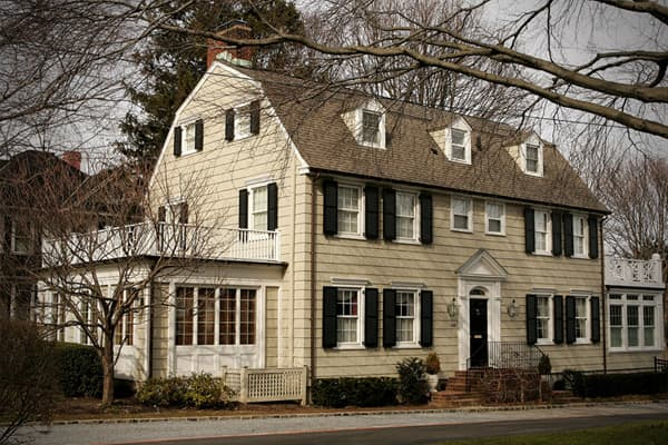 "Location: Amityville, NY Estimated home value: $859,000 Notable ghost: None Although it is the least haunted home on the list, it is a notorious home that was the scene of a horrific murder in November, 1974. The Amityville Horror House is perhaps the most ""commercialized haunted house"" in America. It is where 23-year-old Ron DeFeo, Jr. killed his mother, father, two brothers and two sisters with a rifle as they slept in their beds. The Lutz family purchased the home in 1975 for $80,000, but lef"