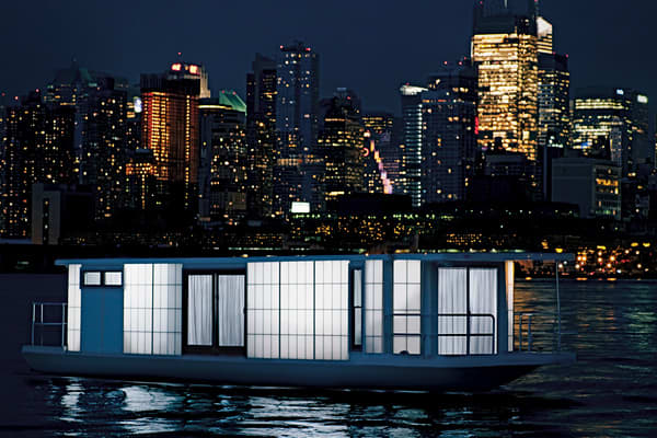 """Price: $250,000 The retailer calls this boat """"the ultimate romantic retreat."""" With a 48-foot by 12-foot open floor plan and 7-foot high interior ceiling, it has been designed and built as an intimate luxury loft that just happens to float. This love nest includes amenties such as a Bang & Olufsen stereo, high-definition projector, Nintendo Wii gaming console and Sony LCD flat screen monitor as well as a gourmet kitchen and a spa bathroom."""
