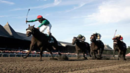 Visionaire winning the 2008 King's Bishop Stakes at Saratoga. He is now standing at stud at Crestwood Farm near Lexington, Kentucky.