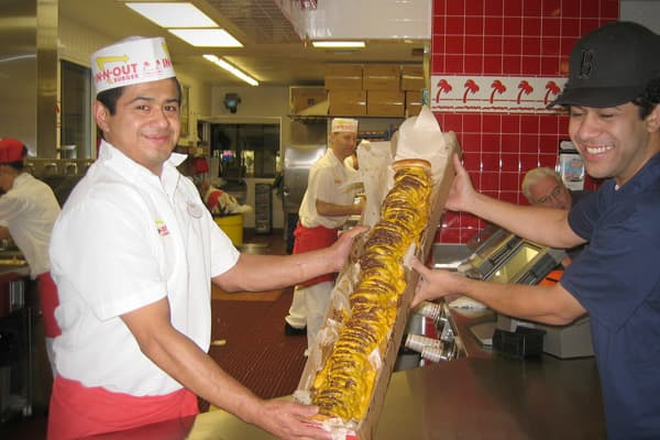 The food at the In-N-Out Burger chain is cooked to order, and if you know how to ask, you can have your burger prepared in ways not formally advertised. Officially, the chain offers the 3x3, or three beef patties and three slices of cheese, and the highest meat to cheese ratio found on the menu is on the 4x4, or four beef patties and four slices of cheese. However, the chain once made the burgers even bigger upon request, making the 6x6 and the 8x8 unauthorized but available options. Sadly, a bu