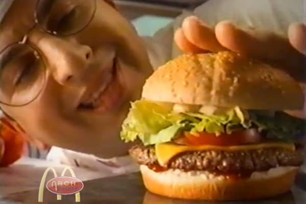 In 1996, McDonald's created the Arch Deluxe, a hamburger intended to appeal to grown-up tastes. It was basically a Quarter Pounder with cheese on a different kind of bun, with peppered bacon and a top-secret mustard and mayonnaise sauce. It was intended to be the leadoff product in a long line of adult-themed menu items, and the company spent $100 million on the ad campaign. It stiffed. The price was markedly higher than the other items on the McDonald's menu, and the very expensive ad campaign
