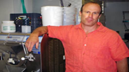 "Mark Mallen, owner of Mile High Ice Cream, pictured with a 10-gallon ice cream maker at the commercial kitchen near downtown Denver where employees make cannabis-infused ""edibles"" for medical marijuana patients."