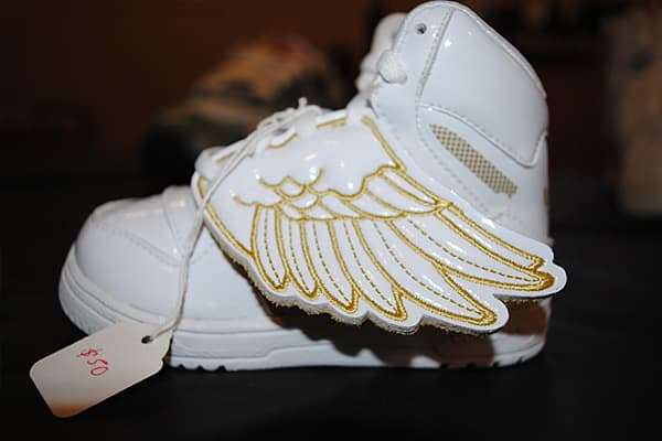 : $50 These tiny kicks bring a whole new meaning to looking fly. Designed by Jeremy Scott for Adidas, these infant-sized sneakers have gold lined wings on one side of each shoe. A similar winged sneaker is also available in adult sizes, said an employee from collectible sneaker store .