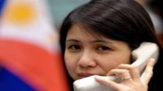 A trader talks on the phone on the trading floor of the Philippine Stock Exchange.