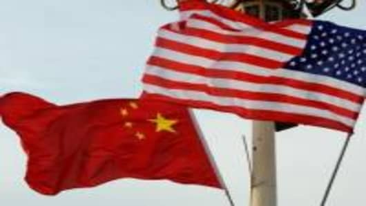 A Chinese and U.S. flag flutter in front of Tiananmen Gate on November 16, 2009 in Beijing of China.