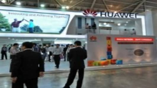 People visiting Huawei Technologies booth display of its product during CommunicAsia 2010 conference and exhibtion show in Singapore.