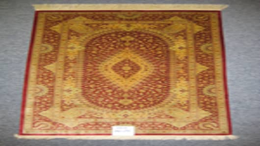 Super-fine silk-on-silk carpet from Kashan, Iran. Measures 4.3 x 6.6 feet and retails for S$10,000 ($7,668)