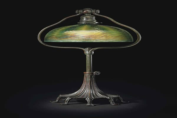 Estimate: $8,000-$12,000 Year: 1910 Dimensions: 24 inches high. 10-inch diameter.