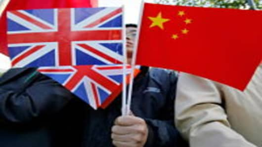A Chinese supporter of President Hu Jintao holds British and Chinese flags on November 9, 2005 in London, England.
