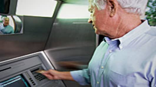Senior using ATM machine