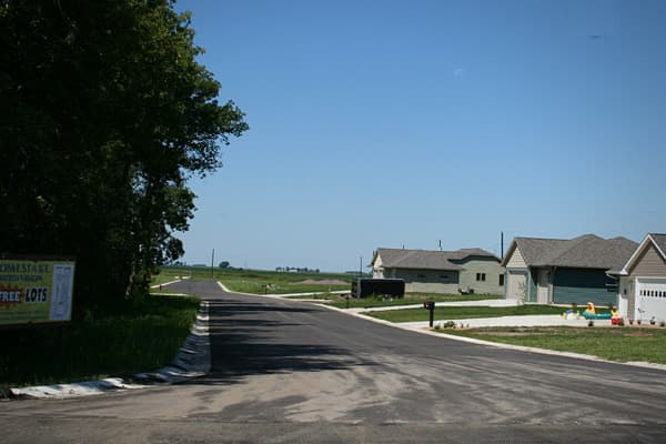 New Richland is a town of about 1200 in southern Minnesota, 75 miles from the outskirts of the Twin Cities, offering lake recreation and many fine churches. If this sounds like home, then consider a free 86' x 133' lot on the Homestake subdivision on the northwest side of town. Those who claim lots must build a house on the property within one year. The land itself is free, but assessments for services provided by the town such as streets, curb and gutter, water and sewer. The fee for these is a