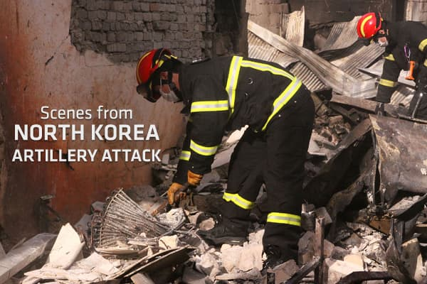 Firefighters from the Incheon Fire and Safety Management Department inspecting the damage caused by the artillery shells fired by North Korea on November 24 in Yeonpyeong Island, South Korea.