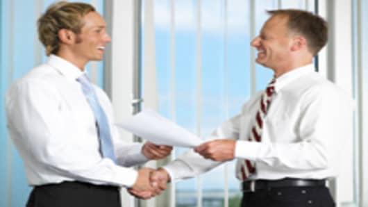 employee_boss_handshake2_200.jpg