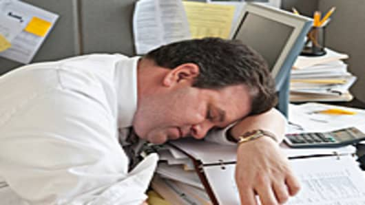 man_sleeping_in_office_200.jpg