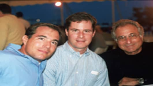 Financier Bernard Madoff (R) with his sons Mark Madoff (L) and Andrew Madoff (C) during July 2001 in Montauk, NY.