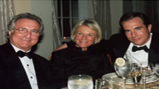 Financier Bernard Madoff with his wife Ruth Madoff and son Mark Madoff during November 2001 in Long Island, NY.