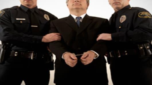 cops_businessman_cuffs_240.jpg
