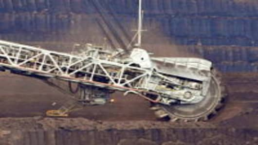 A coal dredger tears coal from the face of the Loy Yang Open Cut coal mine in the Latrobe Valley, 150km east of Melbourne on August 13, 2009.