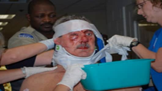 Allen Stanford on a hospital trolly after being assaulted by jail prisoners.