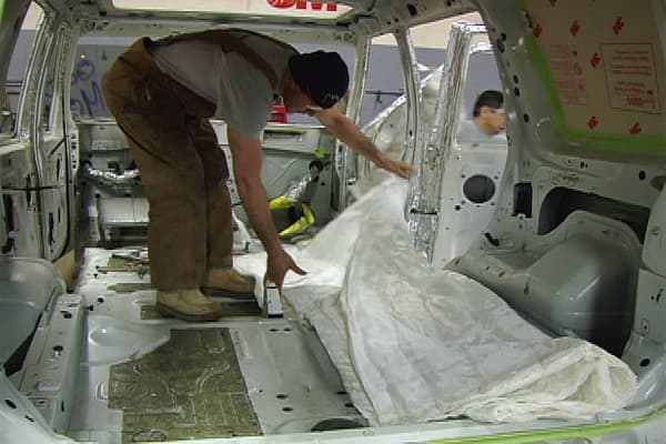 "After a preliminary consultation process, which estimates the level of protection needed by the client, the vehicle's interior is stripped to accomodate the various changes necessary for armoring a car. According to the company, the goal of armoring is to ""create a cocoon of protection by enveloping the passenger cabin, which includes modifications on the glass, floors, pillar posts, roof, doors, fuel tank, tires, batteries and more."