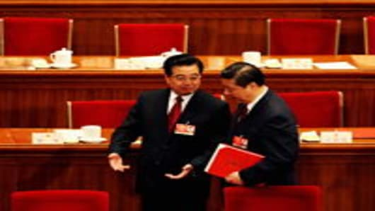 Chinese President Hu Jintao talks with Vice President Xi Jinping at China's Parliament in Beijing, China.