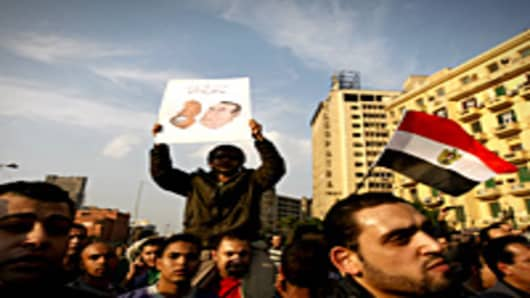 Egyptian demonstrators hold up placards during a protest in central Cairo to demand the ouster of President Hosni Mubarak and calling for reforms.