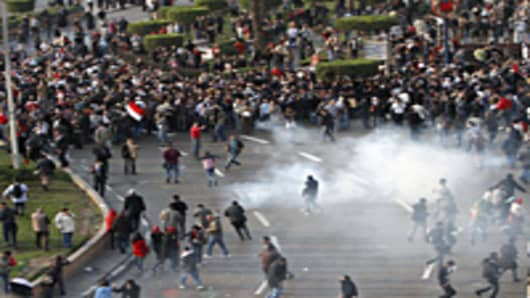 Egyptian demonstrators protest in central Cairo amidst tear gas fire by Egyptian police to demand the ouster of President Hosni Mubarak and calling for reforms.