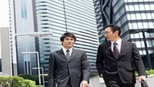Young businessman who walks with superior