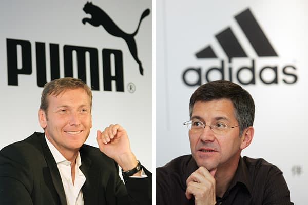 Photo: STR | AFP | Getty Images Left: Puma CEO Jochen Seitz. Right: Adidas CEO Herbert Hainer