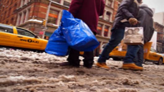Shoppers on Broadway in the snow