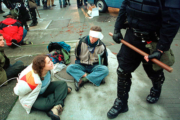 The World Trade Organization Ministerial Conference of 1999 was scheduled to take place in Seattle on November 30. The low-ball estimate is that a record 40,000 anti-globalization activists showed up to protest the meeting, and shut it down entirely if possible. Activists blocked traffic at major intersections, thereby preventing delegates from getting to the conference, and police responded by firing tear gas, pepper spray and, eventually, rubber bullets, to disperse the crowds and get delegate
