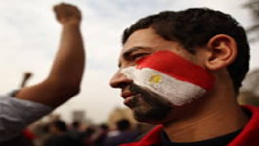 A youth with an Egyptian flag painted on his face stands in Tahrir Square in Cairo, Egypt.
