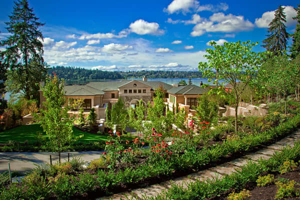 "List Price: $28.8 million Size: 14,000 sq ft Bedrooms: 7 Bathrooms: 12 A home that can take your breath away, the Boulevard Place Estate on Mercer Island in Lake Washington is an example of American romanticism : The home was inspired by Greek revival architecture with curved arches and columns . It features multiple outdoor terraces overlooking water views, rooms with 23 foot ceilings, multiple guest quarters and an outdoor 150"" plasma screen. The home is just outside Seattle, itself offering a"