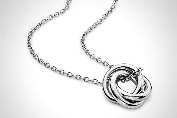 Price: $40 According to the experts at Blue Nile, if you're looking for a gift on a budget, invest in sentimentality. One example is a love knot pendant, which makes a simple statement about love. This example has three freely moving entwined rings suspended from a sterling silver cable chain.