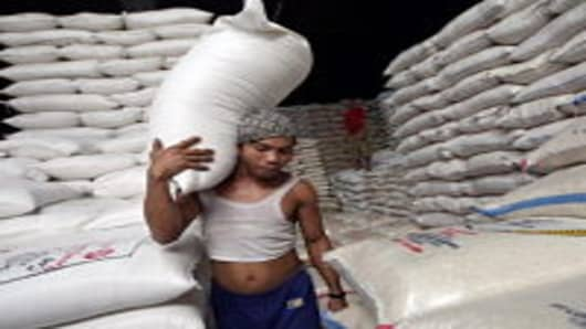 Workers stock pile bags of rice at a rice warehouse on September 1, 2008 in Jakarta, Indonesia. The global rice price has risen by almost 70% this year, raising concerns in Indonesia, which is one of the world's largest consumers.