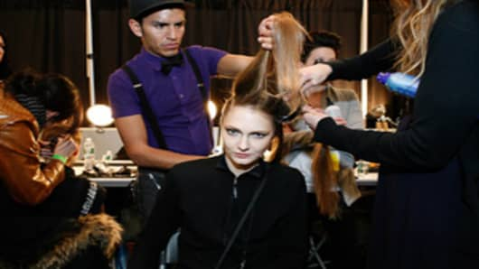 A model gets her hair and makeup done backstage at the Irina Shabayeva fashion show in New York City's Lincoln Center.