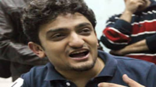 Cyberactivist Wael Ghonim speaks with the press at Cairo's Tahrir square after his release.
