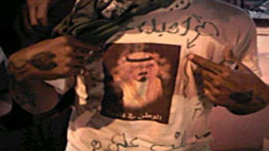 A Saudi man wears a t-shirt with the image of King Abdullah bin Abdul Aziz in the Saudi capital Riyadh.