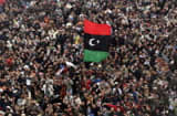 BENGHAZI, LIBYA - FEBRUARY 25: Libyans protest demanding the removal of Libyan leader Muammar Gaddafi following Friday prayers on February 25, 2011 in Benghazi, Libya. Benghazi residents mourned more victims of the violence as fighting continued around the capitol Tripoli.