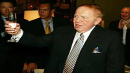 Chairman of Las Vegas Sands, Sheldon Adelson offers a toast during