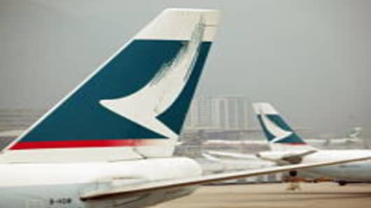 Cathay Pacific airplanes stand on the tarmac of Chek Lap Kok airport in Hong Kong, China.