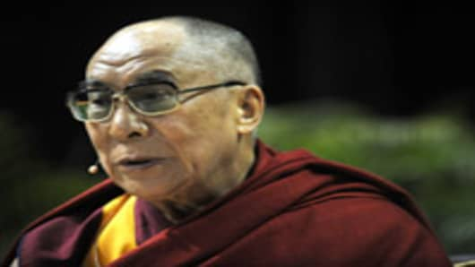 MIAMI - OCTOBER 26: Dalai Lama, Tenzen Gyatso speaks on The Quest for Happiness in Challenging Times at Bank United Center on October 26, 2010 in Miami, Florida. (Photo by Gustavo Caballero/Getty Images)