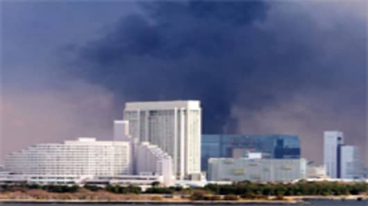 Smoke rises from a construction site due to the strong earthquake on March 11, 2011 in Tokyo, Japan. A magnitude 8.9 strong earthquake hit the northeast coast of Japan.