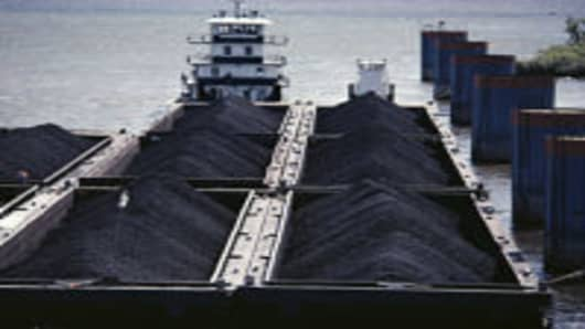 Coal barges being set for unloading at power plant, elevated view