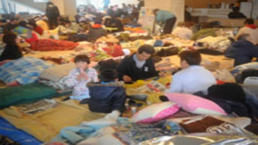 People take shelter at an evacuation centre in Natori, Miyagi prefecture on March 16, 2011.